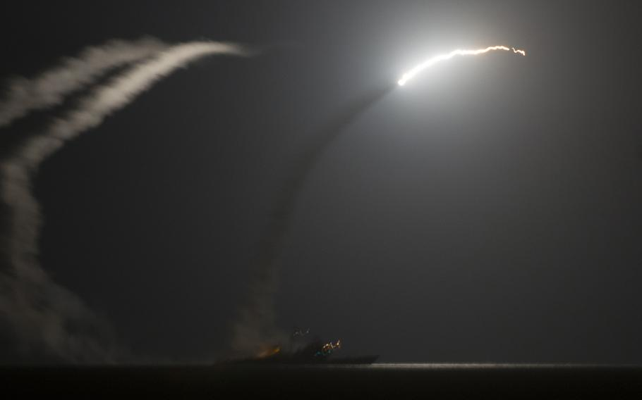 The guided-missile cruiser USS Philippine Sea launches a Tomahawk cruise missile as seen from the aircraft carrier USS George H.W. Bush on Sept. 23, 2014 as the U.S. carried out strikes against the Islamic State in Syria.