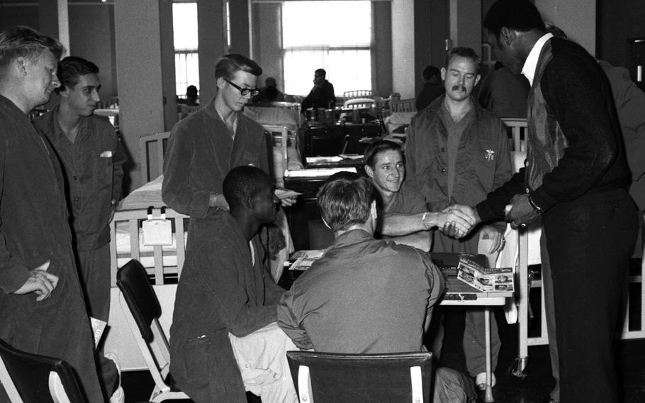 Marv Fleming talks with troops at the U.S. Army Hospital on Camp Oji, Japan, in January, 1969.