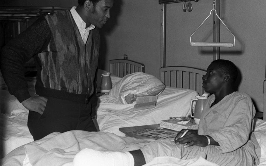 Marv Fleming talks with a servicemember at the U.S. Army Hospital on Camp Oji, Japan, in January, 1969.