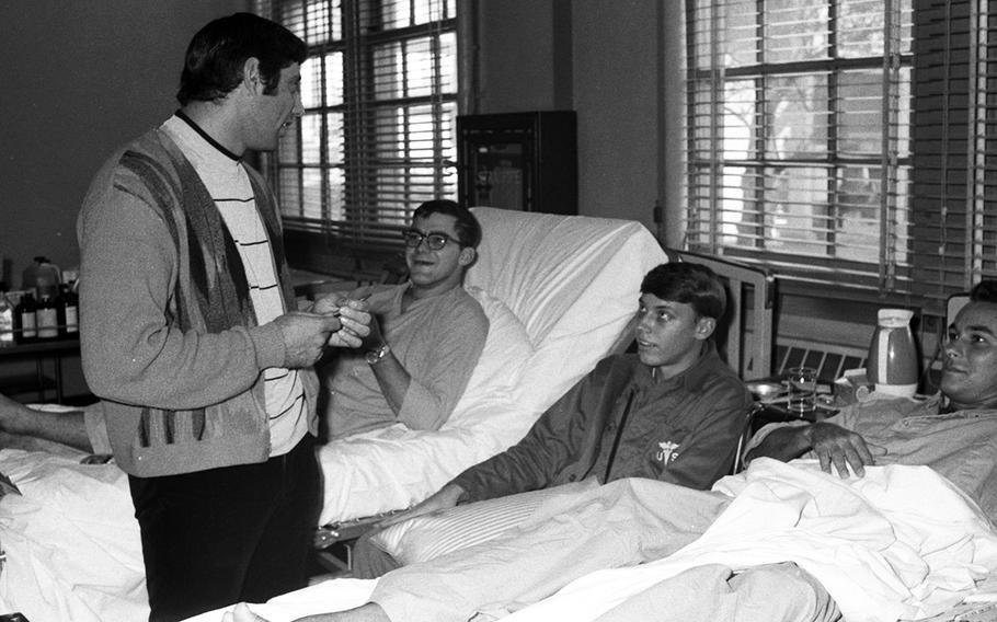 Joe Namath talks with patients at the U.S. Army Hospital on Camp Oji, Japan, in January, 1969.