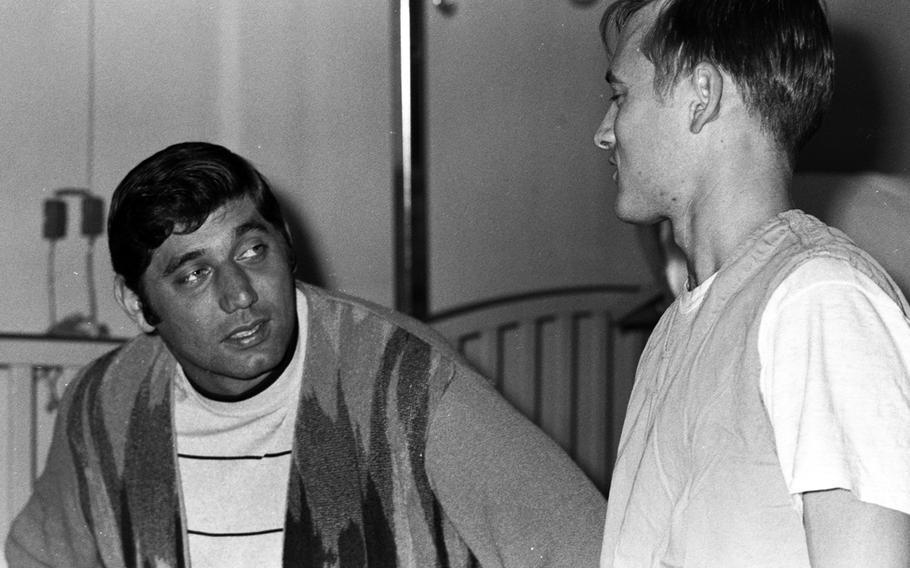 Joe Namath talks with a patient at the U.S. Army Hospital on Camp Oji, Japan, in January, 1969.