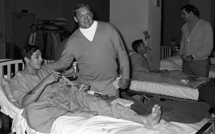 Jim Otto of hte Oakland Raideers talks to a patient at the U.S. Army Hospital on Camp Oji, Japan, in January, 1969.