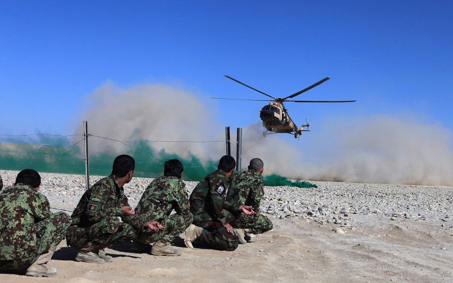Students in the Afghan Tactical Air Coordinator course wait to board a Mi-17 helicopter during the culminating event aboard Camp Shorabak, Helmand province, Afghanistan, Oct. 2, 2014. The weeklong course was designed to familiarize the soldiers with map reading and coordinating with airborne pilots on friendly and enemy troop positions on the battlefield.