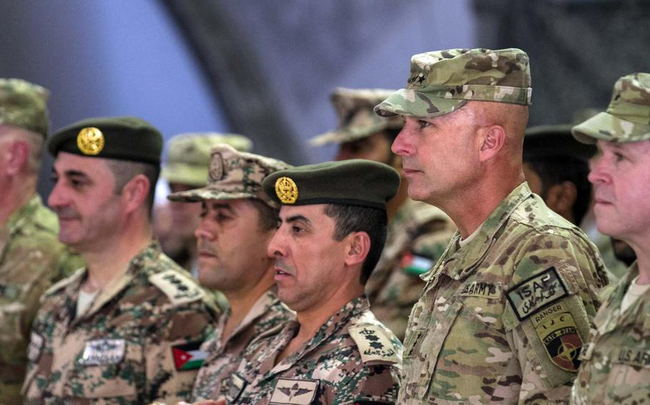 U.S. Army Lt. Gen. Joseph Anderson, right, commander of the International Security Assistance Force Joint Command and 18th Airborne Corps, stands next to Jordanian army Col. Mohammad Al-khraisha during the Jordan armed forces transfer-of-authority ceremony at Bagram Air Field, Afghanistan, on June 25, 2014.