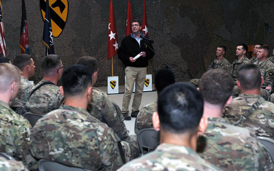 Secretary of Defense Ashton Carter speaks to airmen and soldiers during a visit to Kandahar Airfield, Afghanistan Feb. 22, 2015. Having sworn in only five days prior, the trip was Carter's first official visit to Afghanistan as defense secretary.