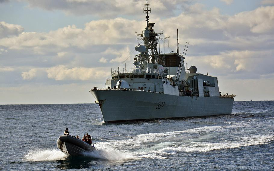 A rigid-hull inflatable boat from the Standing NATO Maritime Group 2 flagship guided-missile cruiser USS Vicksburg departs HMCS Fredericton during a sailor exchange between the U.S. and Canadian ships on Feb. 11, 2015. International warships assigned to the U.S.-led NATO maritime group entered the Black Sea on Wednesday, March 4, 2015, to train with alliance members in the region.