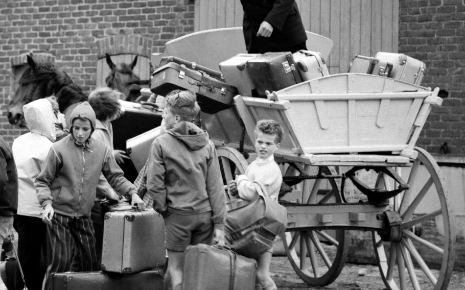 Edgar Braband presides over the unloading of luggage at Neuwerk, West Germany, in 1960.