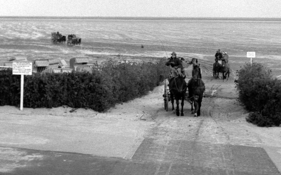 A wagon train arrives at Neuwerk, West Germany, in 1960.