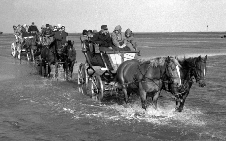 A wagon train to Neuwerk, West Germany, in 1960.