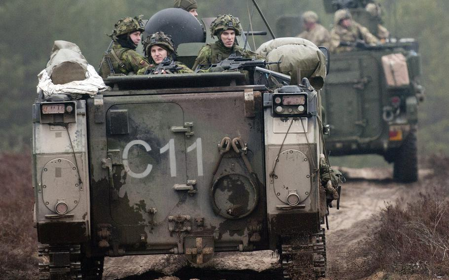 Lithuanian soldiers (left) from 3rd Company, Algirdas Mechanized Infantry Battalion, in a M113 armored personnel carrier, follow U.S. Troopers from 3rd Platoon, Lightning Troop, 3rd Squadron, 2nd Cavalry Regiment, in a Stryker during a live-fire joint training exercise in support of Operation Atlantic Resolve, at Pabrade Training Area, Lithuania, March 2, 2015.