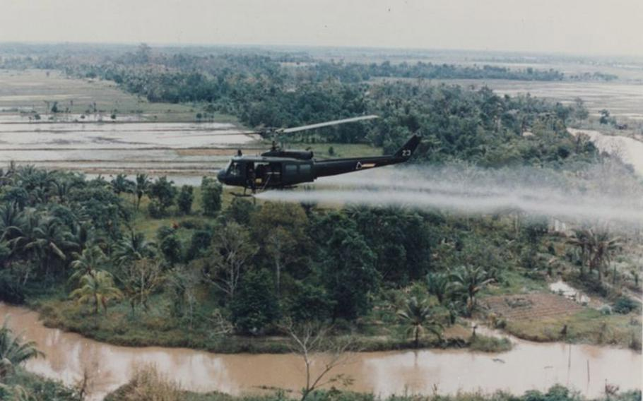 A U.S. military helicopter sprays Agent Orange over Vietnam in this undated photo from the war.