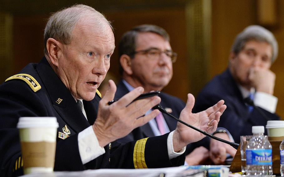 Chairman of the Joint Chiefs of Staff Gen. Martin Dempsey, left, testifies at a Senate Foreign Relations Committee hearing on Capitol Hill, March 11, 2015. Joining him were Secretary of State John Kerry, right, and Defense Secretary Ashton Carter.