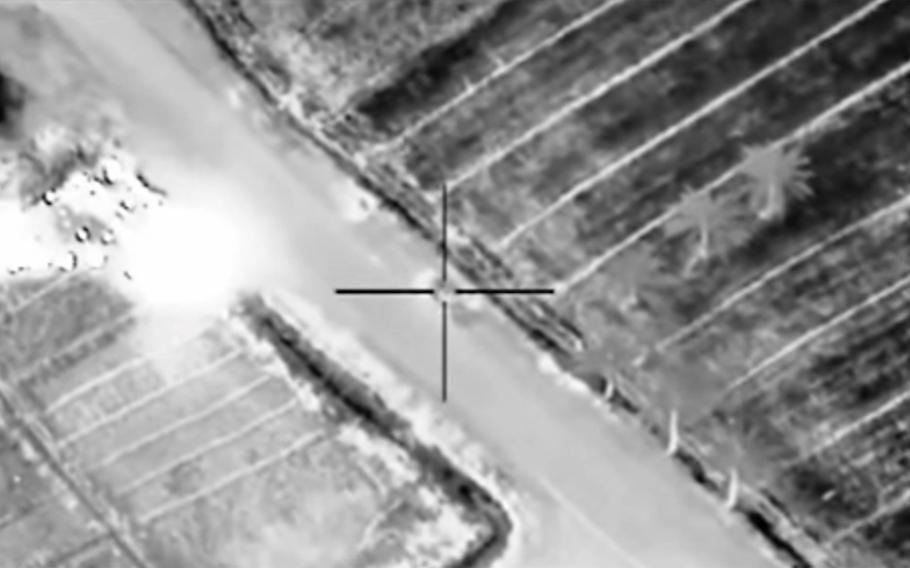 In this image taken from U.S. Central Command video, a coalition airstrike targets an Islamic State compound March 8, 2015, near Fallujah, Iraq.