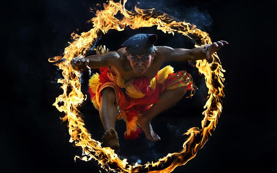 """Aprison Aprison, """"Jump!""""   One of traditional attraction in Indonesia Culture called Bujang Ganong. He jumped into the circle of fire."""