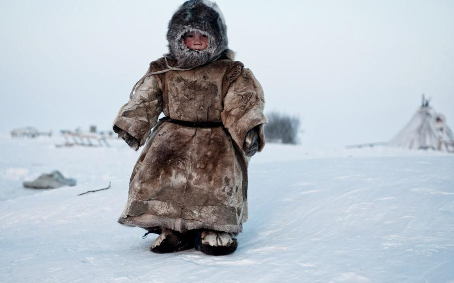 """Simon Morris, """"On the Tundra...""""   A Young Nenets boy plays in -40 degrees on Yamal in the Winter in Siberia."""