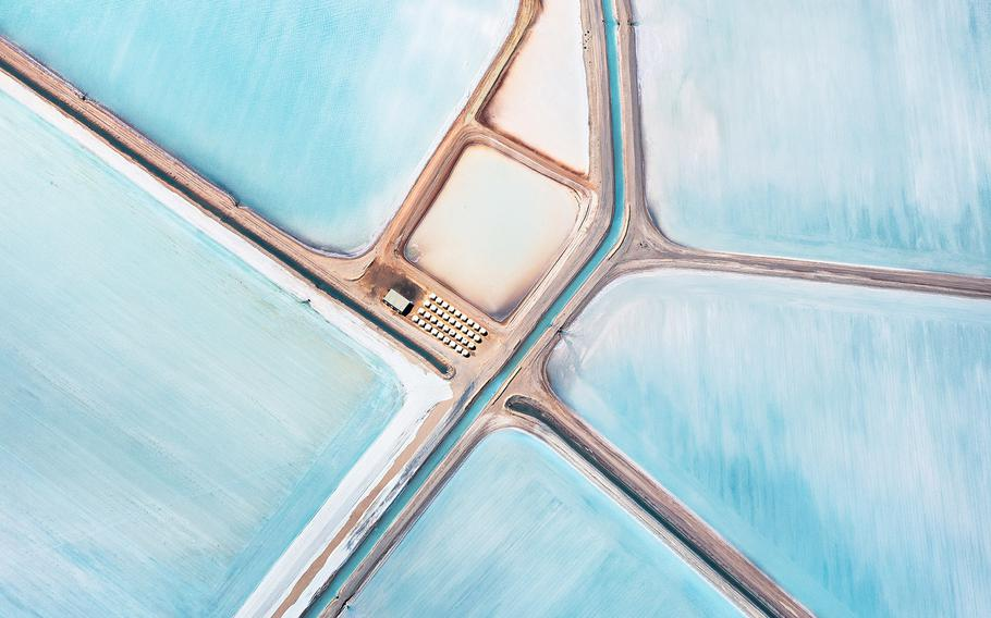 """Simon Butterworth, """"Blue Fields, 1""""   The images were shot from a light aircraft flying at between 4,000 & 5,000ft. The height was crucial in order to flatten perspective by using long focal lengths. Time of day and cloud cover were also critical, the abstract effect being heightened by complete lack of signifying shadow."""