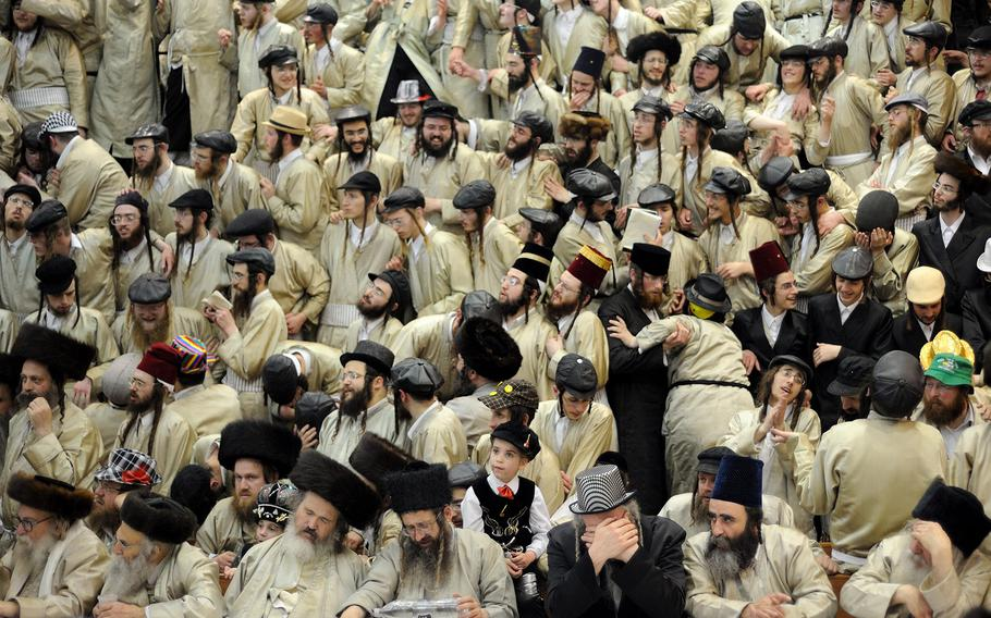 """Gili Yaari, """"Purim Holiday in Jerusalem1""""   Ultra-Orthodox Jewish men of the Toldot Aharon Sect celebrate the Purim holiday in the ultra-orthodox Mea Shearim neighborhood in Jerusalem on March 17, 2014. The festival of Purim commemorates the rescue of Jews from a genocide in ancient Persia."""