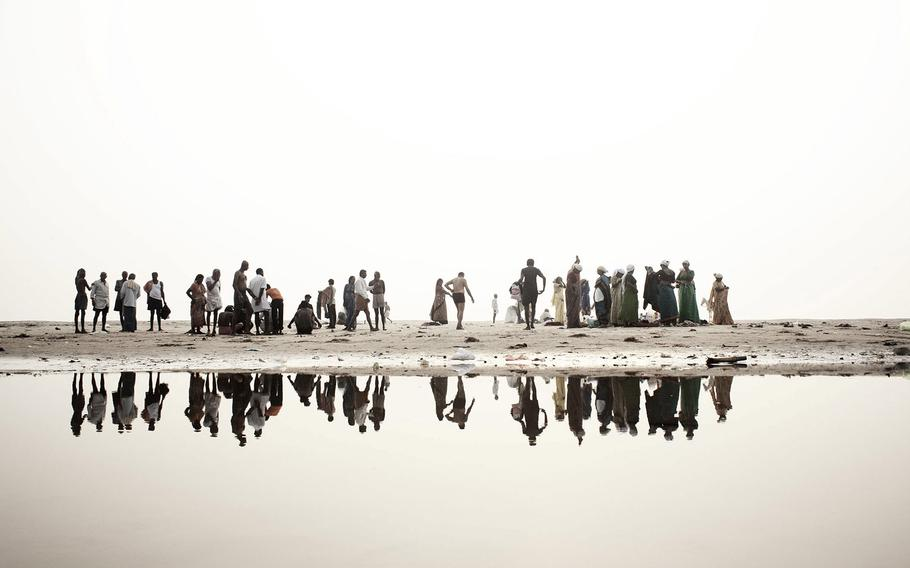 """Giulio di Sturco, """"Ganges, Death of a River, 2""""   Hindu devotees' Along the banks of the river Ganges, get ready to soak in the water of the sacred river, India 2008."""