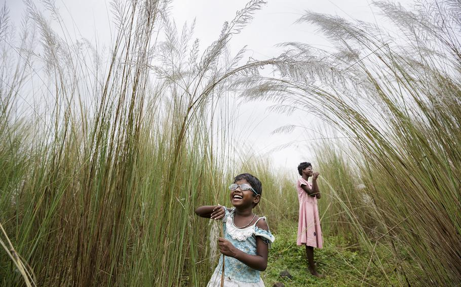"""Brent Stirton, """"First Sight 2""""   Blind girls Sonia, 12, and Anita Singh, 5, are born into poverty with congenital cataract blindness. They must accompany their parents everywhere as they cannot be left alone without risk."""