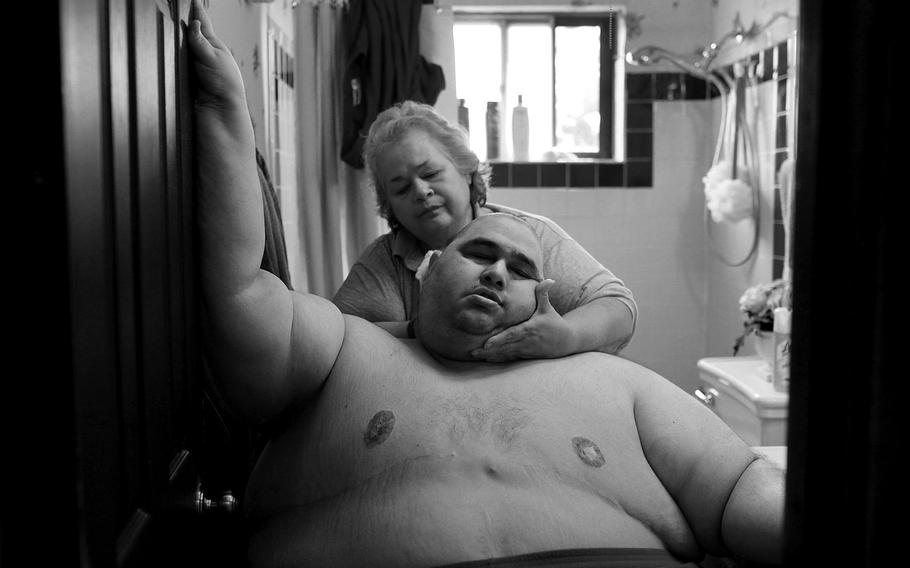 """Lisa Krantz, """"A Life Apart: The Toll of Obesity 1""""   At almost 600 pounds, Hector Garcia Jr. finds simple daily tasks like bathing a challenge. He struggled to walk across the hall from his bedroom to the bathroom so that his mother, Elena, could wash him after having cut his hair in November 2010. A month before, Hector started dieting after he realized he was close to his highest known weight, 636 pounds."""