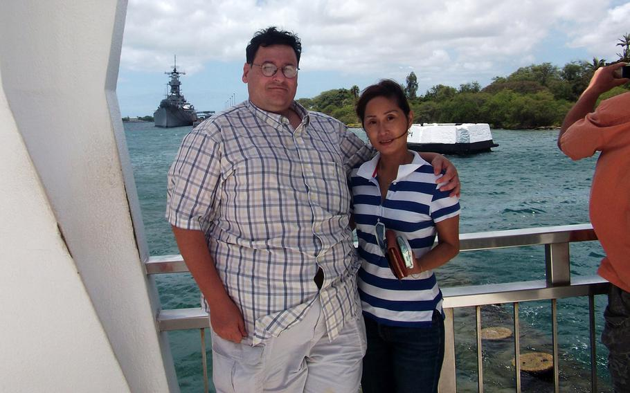 David and Li-Rong Radich pose at the USS Arizona Memorial in Honolulu. After his wife was brutally attacked in 2010, David Radich considered buying a handgun for self-defense, but laws currently prevent him from owning one on the U.S. Commonweath of Northern Mariana Islands.