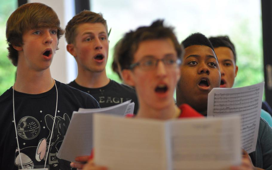 Student vocalists, from left, Ramstein's Aaron Young, Kaiserslautern's Caleb Chastain, Lakenheath's Quintin Pitts and Ramstein's Shamar Armprester sing Mozart's ''Veni Sancte Spiritus'' during rehearsals Tuesday for the annual DODDS-Europe Honors Music Festival. This year, 154 students were selected to participate.