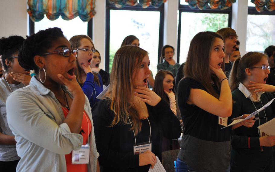 Vilseck's Crystal Morris, from left,  Alconbury's Mary Margaret McKillop, Patch's Chesney Walters and Ankara's Abigail Hansen practice a singing technique during rehearsals Tuesday at the annual DODDS-Europe Honors Music Festival in Oberwesel, Germany.
