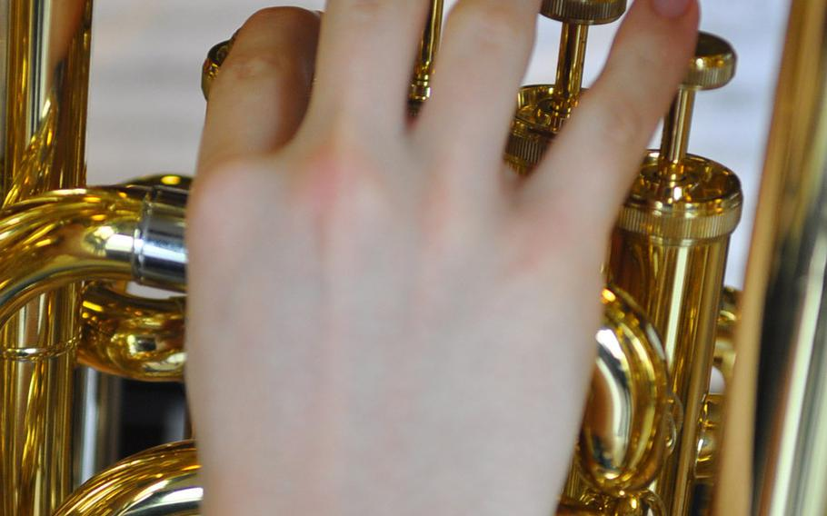 Fingers move over the keys of a brass instrument during band rehearsal Tuesday at the DODDS-Europe Honors Music Festival at Oberwesel, Germany.