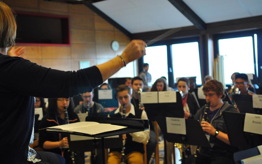 Mary Schneider, the guest instrumental conductor for this year's DODDS-Europe Honors Musical Festival, leads the band in rehearsals Tuesday, March 24, 2015, at the Oberwesel Youth Hostel in Germany.
