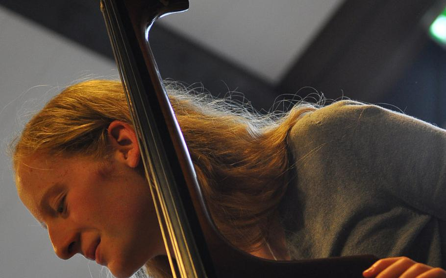 Baileigh McFall of Bitburg smiles while playing the string bass during rehearsals Tuesday, March 24, 2015, for the annual DODDS-Europe Honors Music Festival at Oberwesel, Germany.