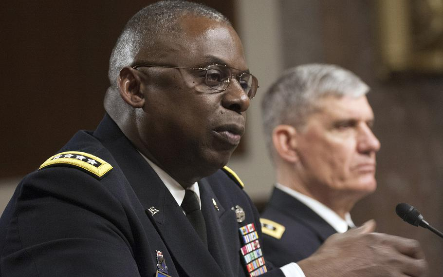 Gen. Lloyd J. Austin, commander of the U.S. Central Command, answers a question during a Senate Armed Services Committee budget hearing Thursday, March 26, 2015, in Washington. Next to him is AFRICOM commander Gen. David M. Rodriguez. Austin told lawmakers that there were a number of preconditions that had to be met before the U.S.-led coalition would come to the rescue of the stalled offensive in Tikrit.