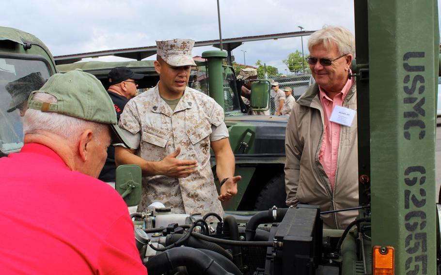 A Marine with 1st Reconnaissance Battalion talks to veteran David Estenson on Thursday, April 23, 2015, at Camp Pendleton, Calif., at a reunion of Vietnam-era reconnaissance Marines.