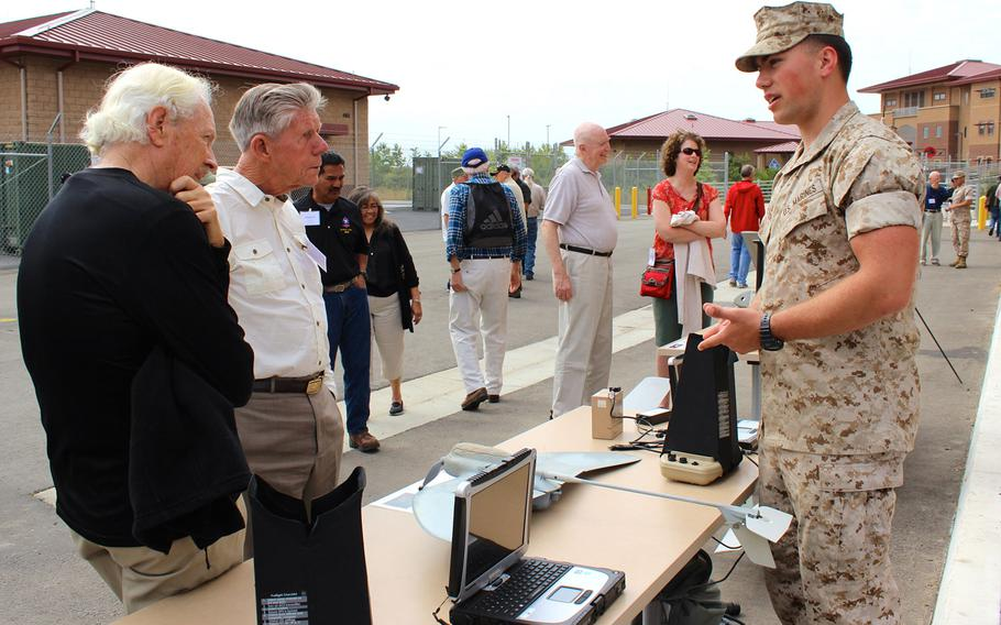 A Marine with 1st Marine Reconnaissance Battalion talks to Vietnam-era recon veterans about a drone Thursday, April 23, 2015, during a veterans' reunion event at Camp Pendleton, Calif.