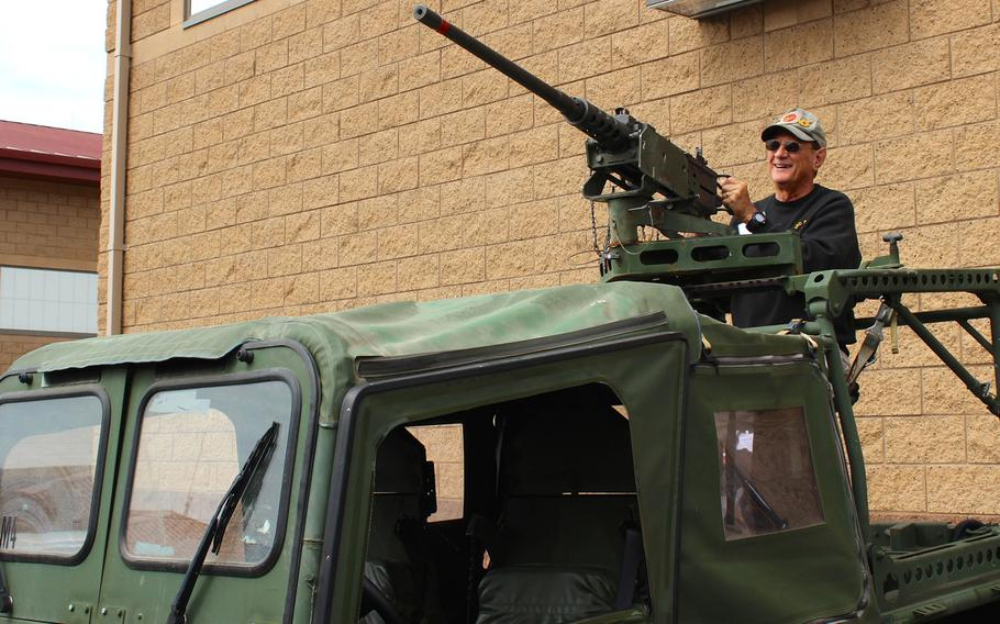 A Marine reconnaissance veteran poses with a 50-caliber machine gun mounted on an intermediate transportable vehicle Thursday, April 23, 2015, at Camp Pendleton, Calif., during a reunion for Vietnam-era vets.