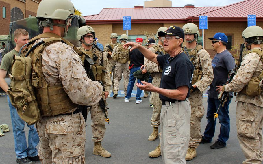 A Vietnam-era reconnaissance corpsman talks to current members of 1st Marine Reconnaissance Battalion on Thursday, April 23, 2015, at a recon reunion at Camp Pendleton, Calif., to commemorate the 50th anniversary of the U.S. entering the Vietnam War.