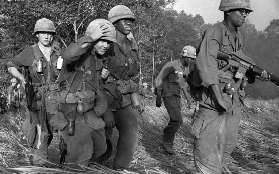 Wounded soldiers are evacuated from an area near Dau Tieng, Vietnam, in November, 1966.