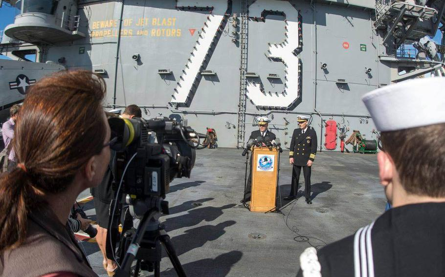 Rear Adm. John Alexander speaks with reporters after aircraft carrier USS George Washington's arrival last week in Brisbane, Australia, for a goodwill port visit ahead of Talisman Saber 2015.