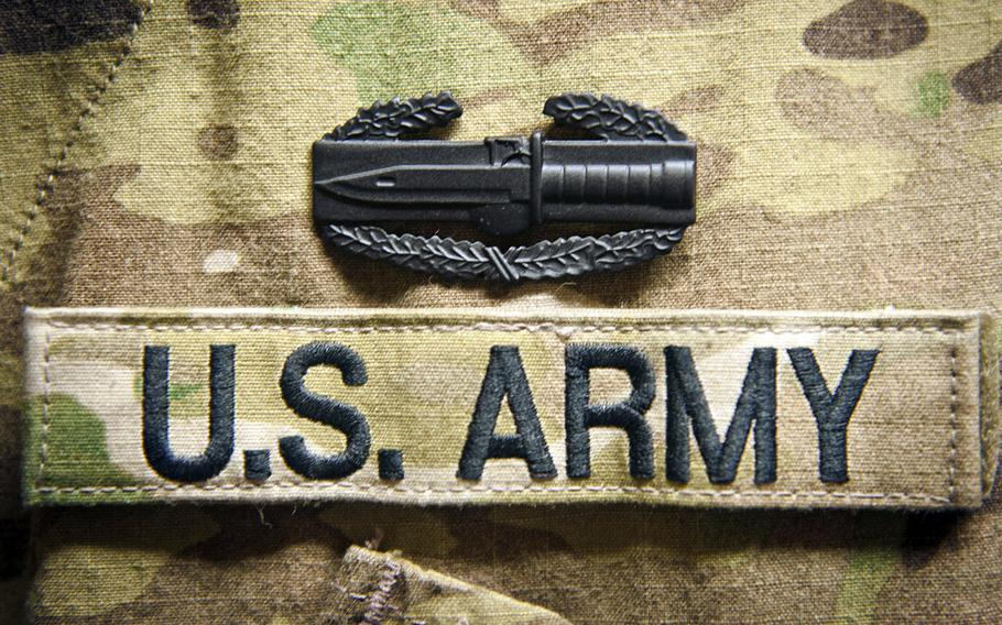 A Combat Action Badge is displayed on a multicam uniform minutes after the soldier received it.