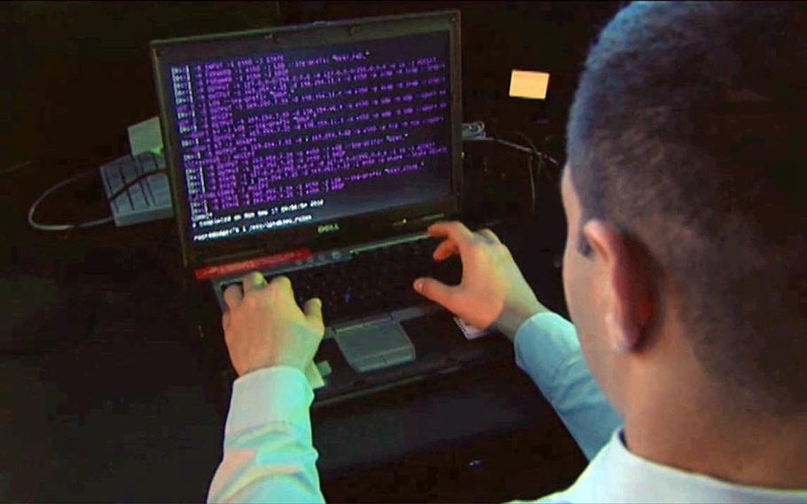 This video screen grab shows Department of Defense personnel receiving training to defend against cyber attacks.