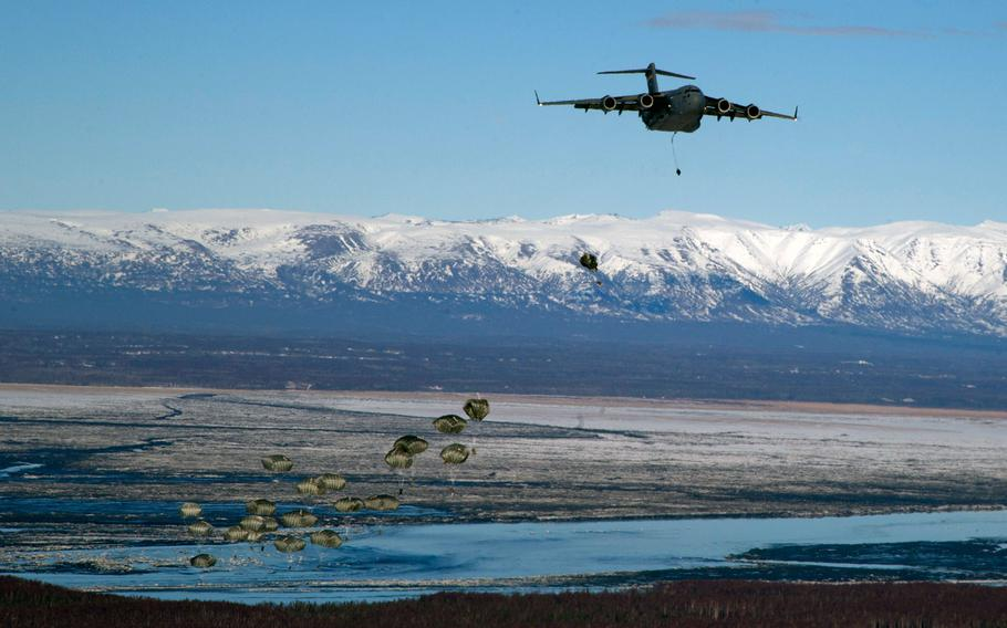 Soldiers assigned to the 725th Brigade Support Battalion, 4th Infantry Brigade Combat Team (Airborne), 25th Infantry Division, jump from an Air Force C-17 Globemaster III as part of a proficiency jump over Malemute Drop Zone, Joint Base Elmendorf-Richardson, Alaska, Feb. 27, 2014.