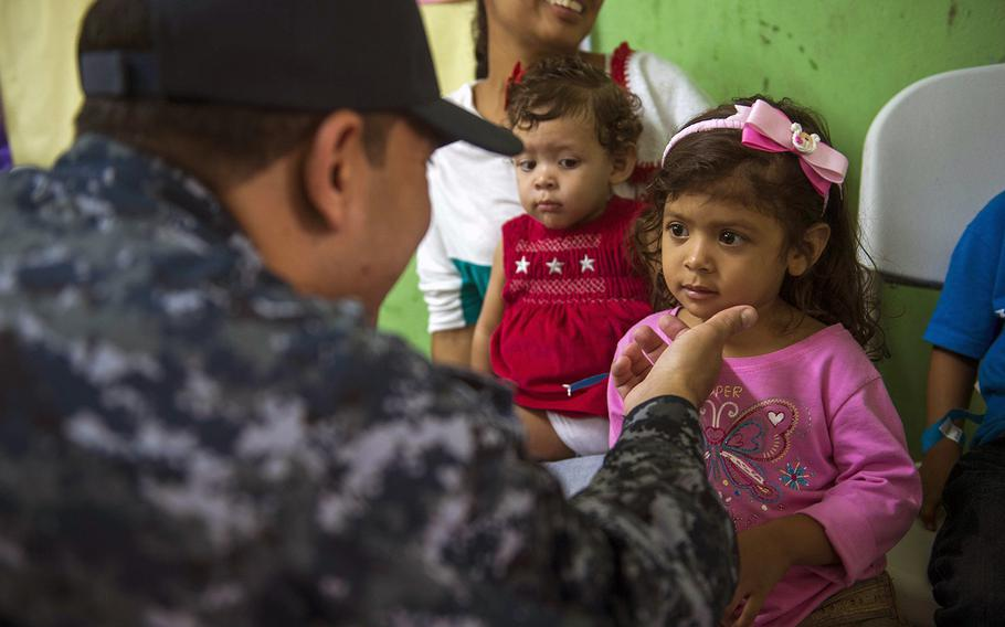 Medical Treatment Facility Command Senior Chief Aurelio Ayala, assigned to Military Sealift Command hospital ship USNS Comfort speaks with patients at a medical site established at Colon, Panama, on May 31, 2015, during a civil-military operation. Ayala was relieved of his duties July 9, 2015, following an alcohol-related incident.