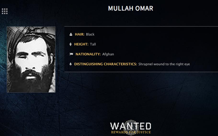 """In this image released by the FBI, Mullah Mohammed Omar is seen in a wanted poster. The reclusive Afghan Taliban leader has backed peace talks with the Kabul government, saying in a rare message distributed to media Wednesday, July 15, 2015 that the goal of these efforts is an """"end to occupation"""" by foreign forces."""