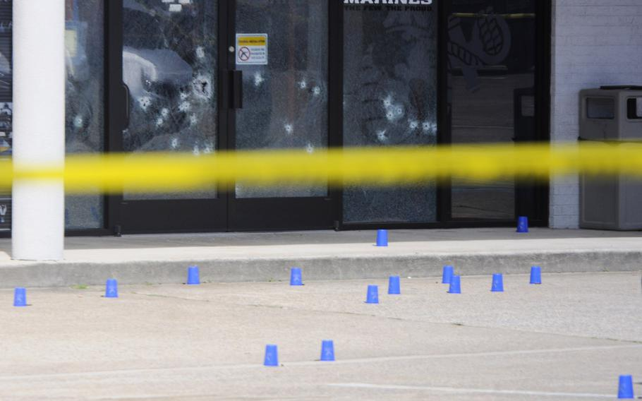 Several bullet holes can be seen in the windows of the Armed Forces Recruitment Center on Thursday, July 16, 2015, in Chattanooga, Tenn.