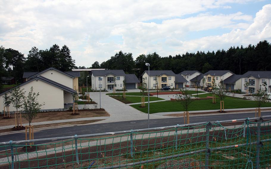 Seven completed housing units await their tenants in Spangdahlem Air Base, Germany. More than 130 other housing units were under construction across the street.