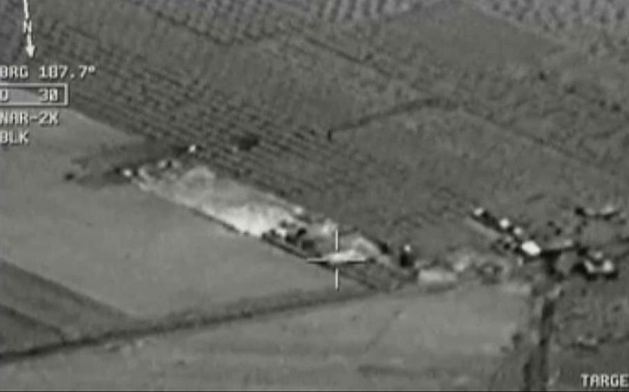 Image from aircraft cockpit video released by Turkey's state-run agency Anadolu Friday, July 24, 2015, of what they report to be Turkish warplanes striking Islamic State group targets across the border in Syria. Black object at centre above target is bomb shortly before impact. Earlier a government official said three F-16 jets took off from Diyarbakir airbase in southeast Turkey early Friday and used smart bombs to hit three IS targets across the Turkish border province from Kilis. The official, who spoke on condition of anonymity because of government rules requiring prior authorisation for comment, said the targets were two command centres and a gathering point of IS supporters. The official said the Turkish planes had not violated Syrian airspace.