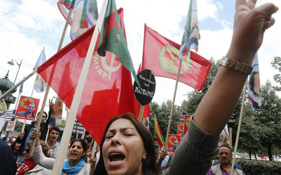 Kurdish demonstrators protest near Turkish Embassy  in Paris, France, Monday, July 27, 2015, denouncing the deaths of 32 people in a suicide bombing last Monday, in Suruc, southeastern Turkey. Turkish warplanes struck Islamic State group targets across the border in Syria early Friday, in a strong tactical shift for Turkey which had long been reluctant to join the U.S.-led coalition against the extremist group.