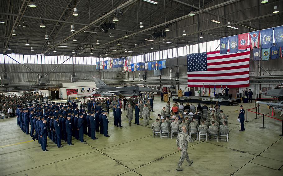 Airmen attend a ceremony in a hangar at a Spangdahlem Air Base, Germany, on June 18, 2015. Air Force officials in Europe will ask the Pentagon to consider forgiving over-payments of roughly $4 million in Overseas Housing Allowances to about 1,500 airmen.