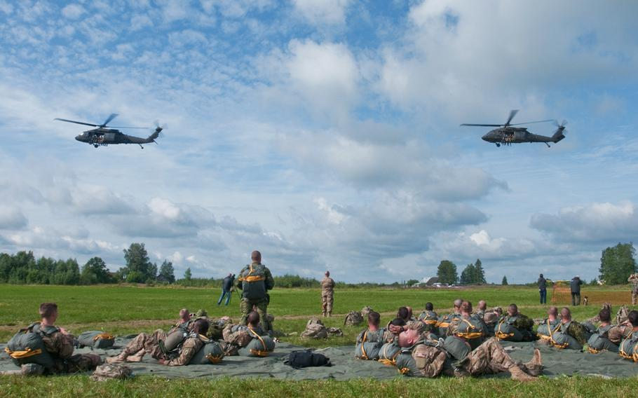 U.S. Army Aviation Soldiers with B Company, 4th Battalion, 3rd Aviation Brigade, 3rd Infantry Division, in their two UH-60m Black Hawk helicopters, depart from the loading area with chalks one and two July 23, 2015 at a drop zone in Nurmsi, Estonia.