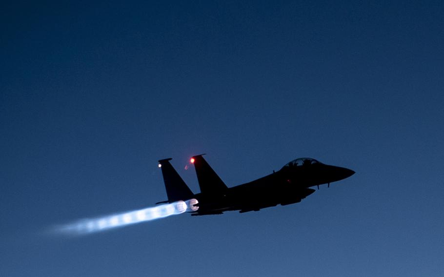 In this Sept. 23, 2014 file photo, a U.S. Air Force F-15E Strike Eagle flies over northern Iraq early in the morning after conducting airstrikes in Syria.