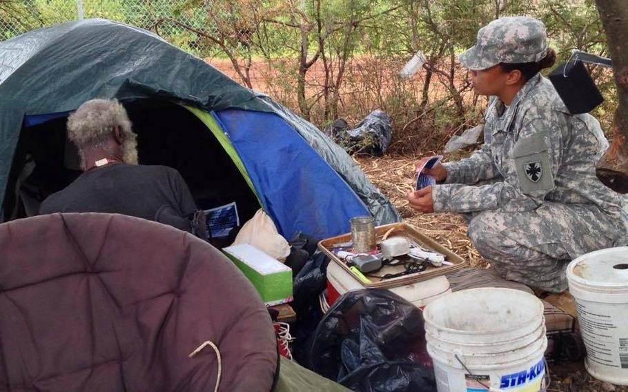 Sgt. 1st Class Nicole Howell talks with a homeless veteran about the upcoming 2015 Veterans Stand Down, Aug. 5, 2015. Troops separated from military service because of misconduct are far more likely to become homeless than other veterans, a new study has found.